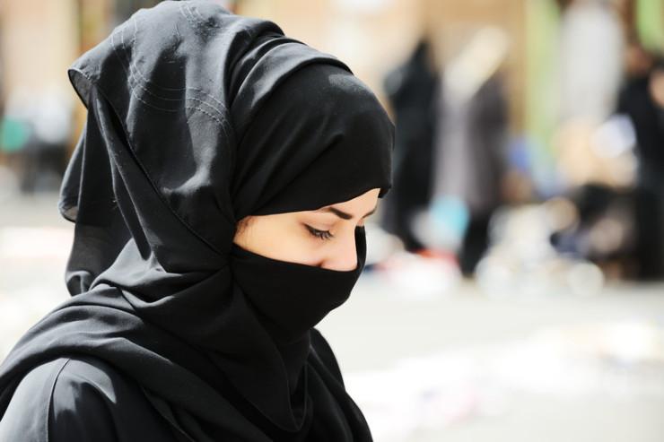 Woman wearing niqab.